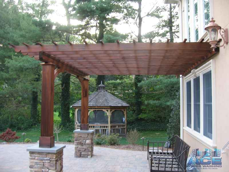 Staining of Ipe Pergola with oil based stain in Park Ridge, NJ